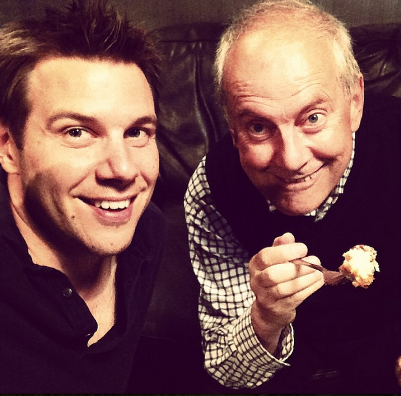 Gyles Brandreth and Tony Wrighton eating cake - is this the secret to happiness?