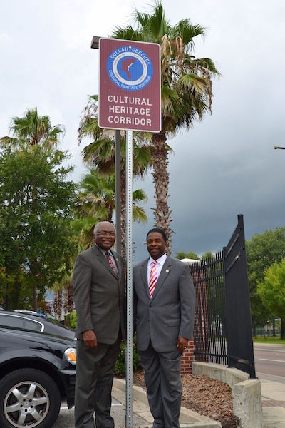SOUTH CAROLINA CONGRESSMAN JAMES CLYBURN (L) AND JACKSONVILLE, FL MAYOR ALVIN BROWN (R) STANDING BY A NEW GULLAH GEECHEE CULTURAL HERITAGE CORRIDOR SIGN IN JACKSONVILLE, FL