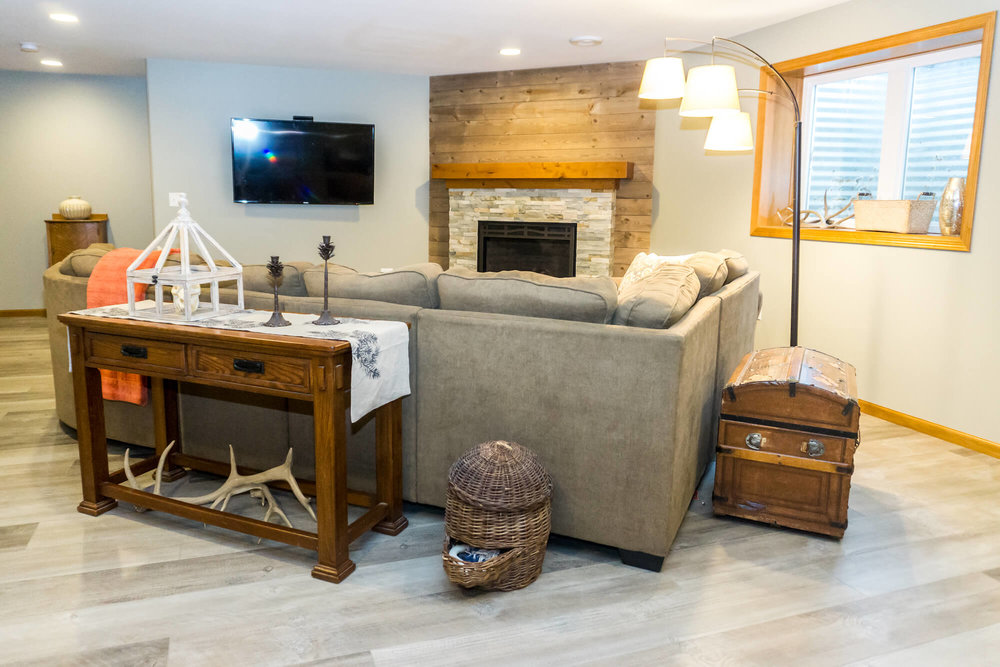 Finished Basement With Tall Ceilings Rich Wood Tones And A Great