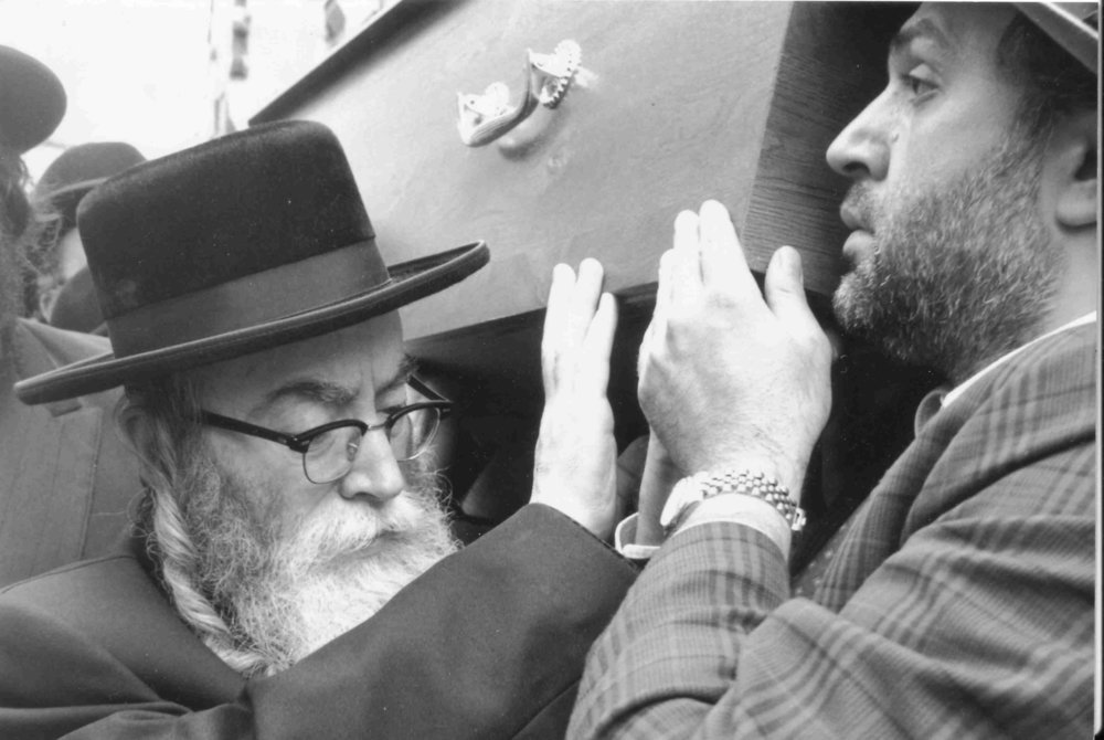 """Rav Leibish, current Rebbe of Pshevorsk שליט""""א carrying the aron of Rav Chaikin זצ""""ל"""