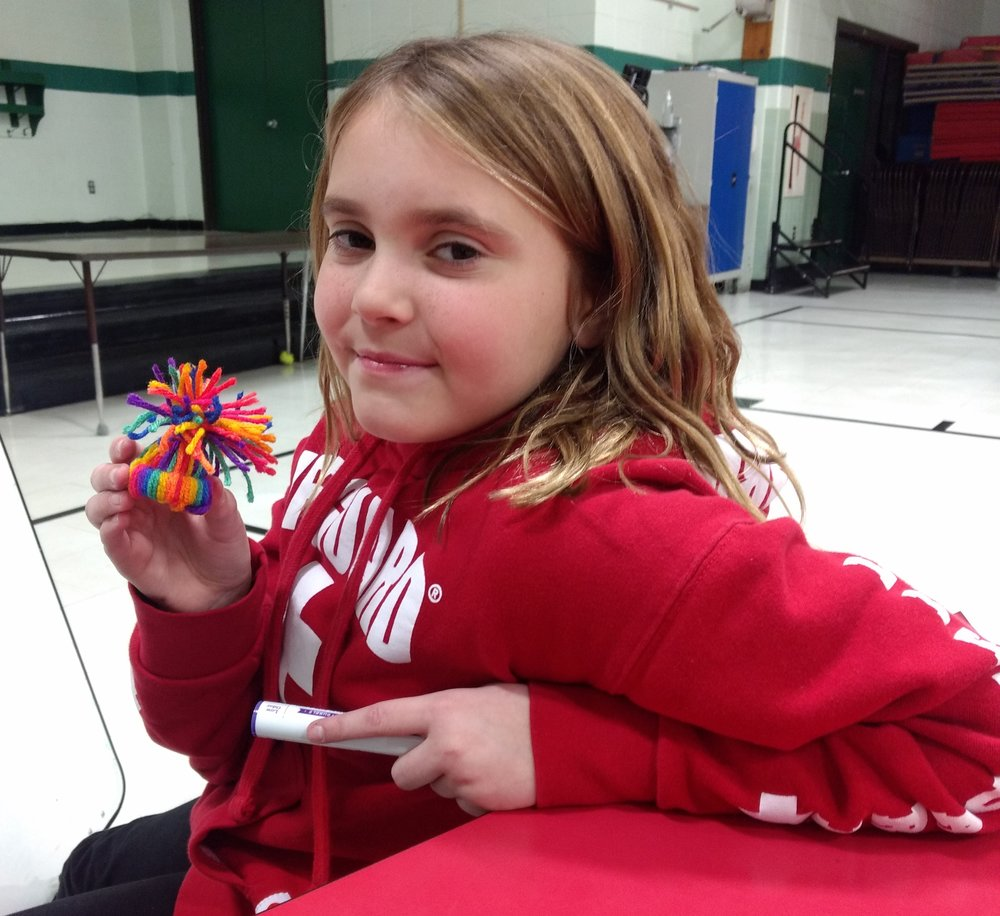 - Abby made knit hat ornaments to sell to people in the community.