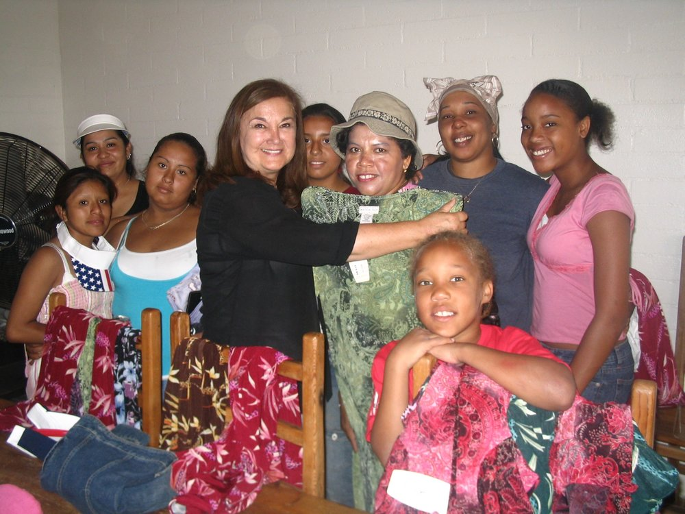 CLF Founder Maria D'Angelo with some of the moms & kids