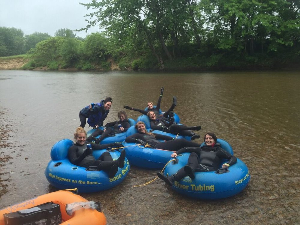 tubing in wetsuits.jpg