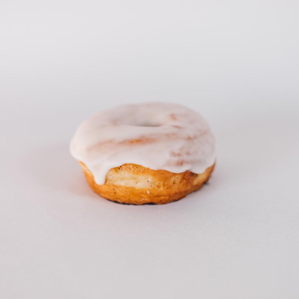 Plain Jane - Yeast risen and deep fried doughnut dipped in vanilla glaze.