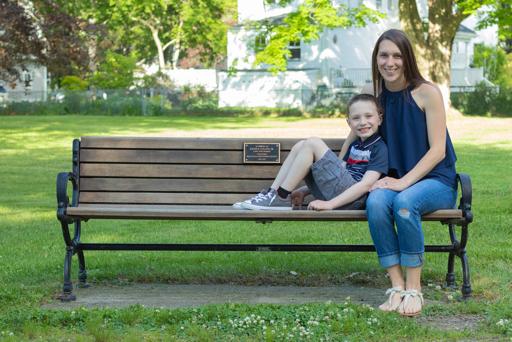 Mother and son family portrait sitting on bench in park in Newburyport, MA photographed by Vision Balm in Charleston, SC.