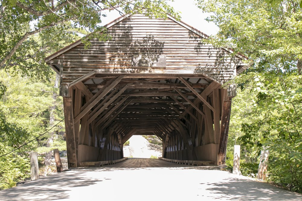 Photograph of the Albany Covered Bridge in the White Mountains in New Hampshire by Vision Balm in Charleston, SC.