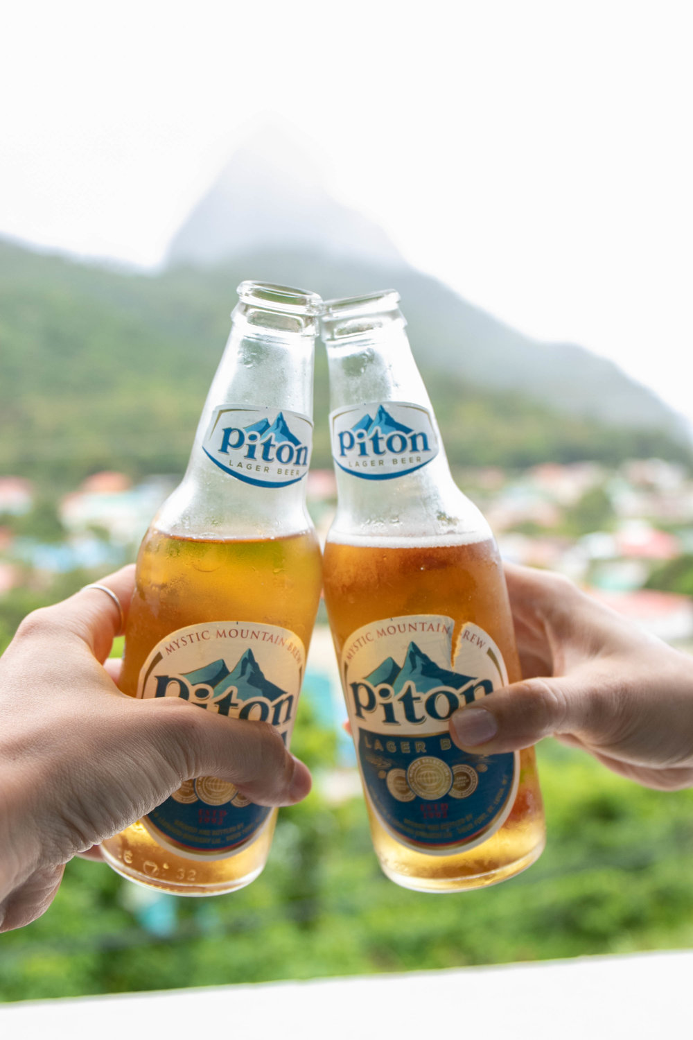 View of the Pitons in Soufriere, St Lucia with Piton beer photographed by Vision Balm in Charleston, SC.