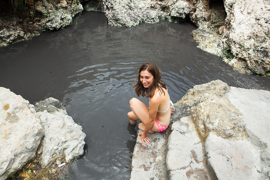 Photo of woman in Sulfur Springs in St. Lucia by Vision Balm in Charleston, SC.