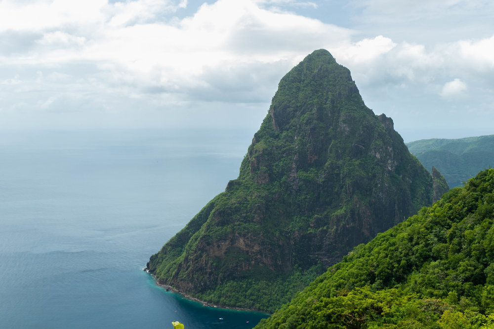 Photo of two women in the Tet Paul Nature Trail overlooking the Pitons in St. Lucia by Vision Balm in Charleston, SC.