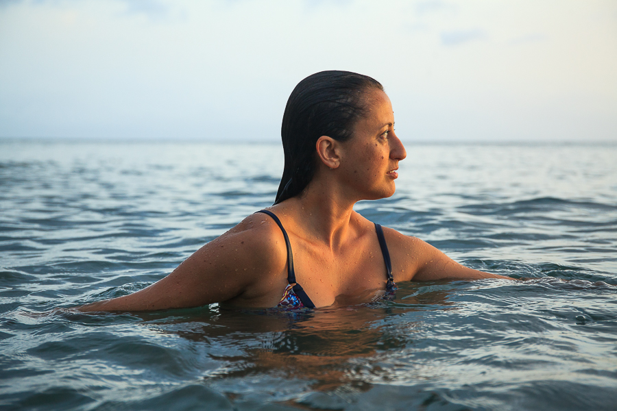 Photo of woman in Anse Chastanet Beach in St. Lucia by Vision Balm in Charleston, SC.
