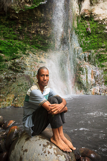 Photos of two woman hiking to Superman Falls in St. Lucia by Vision Balm in Charleston, SC.