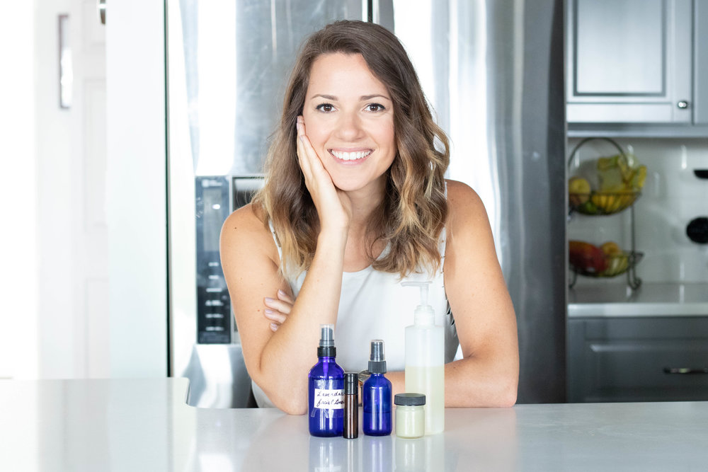 Professional lifestyle portrait of Natasha Wellness leaning on kitchen counter top photographed by Vision Balm in Charleston, SC.