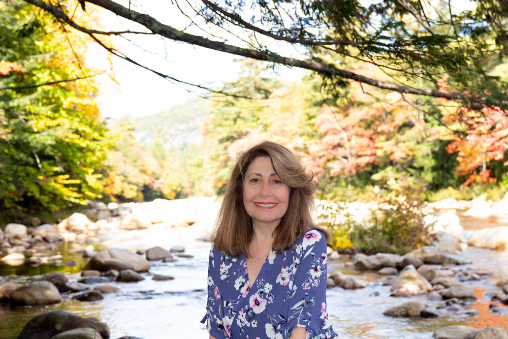Portrait of woman on the Kancamagus Highway in North Conway, New Hampshire during fall by Vision Balm in Charleston, SC.
