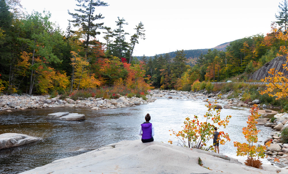 Landscape photo of a river along the Kancamagus Highway in North Conway, New Hampshire in fall by Vision Balm in Charleston, SC.