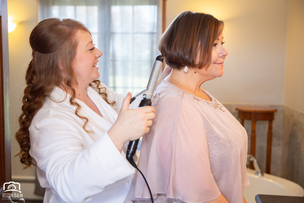 Lifestyle photo of bride and bride's mother getting ready for wedding at Zuka's Hilltop Barn by Vision Balm in Charleston, SC.