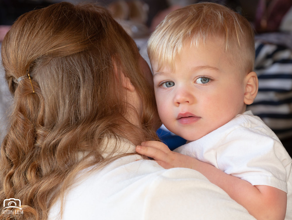 Lifestyle family portrait of bride and her son in Zuka's Hilltop Barn by Vision Balm in Charleston, SC.