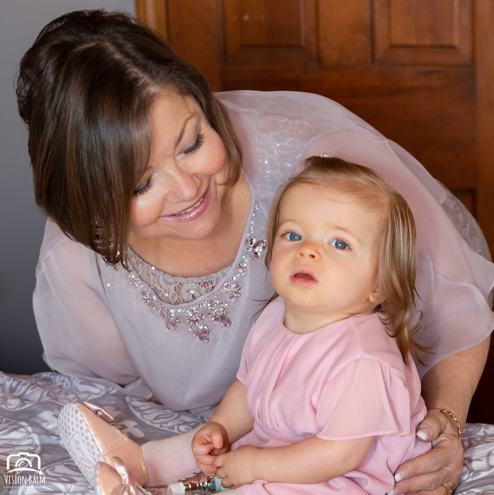 Lifestyle family portrait of bride's mother and her daughter in Zuka's Hilltop Barn by Vision Balm in Charleston, SC.