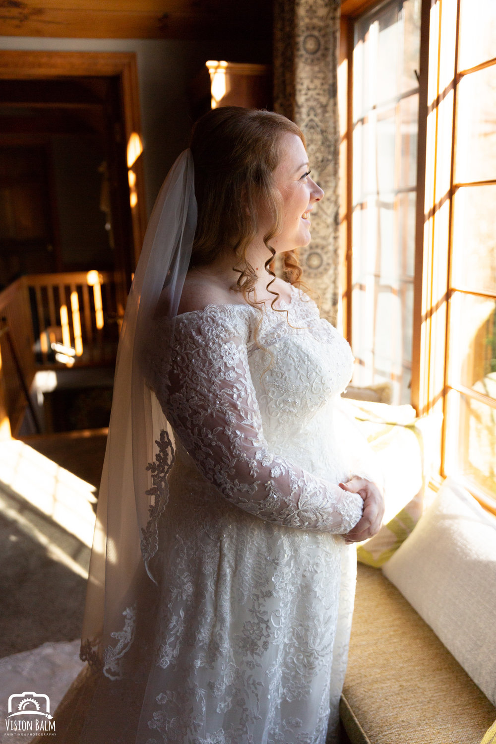 Lifestyle wedding photo of bride in her dress in Zuka's Hilltop Barn by Vision Balm in Charleston, SC.