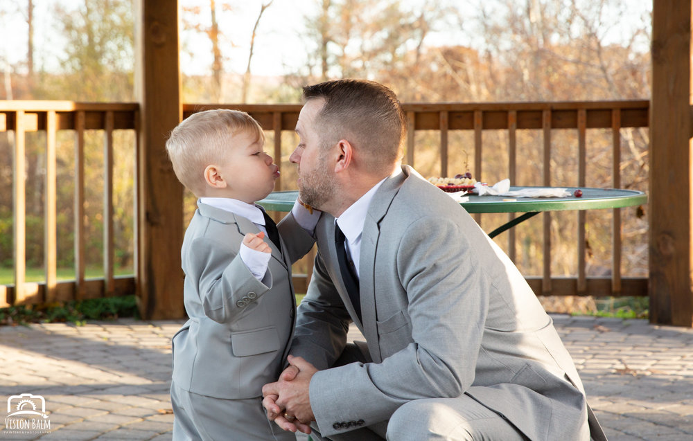 Wedding photo of groom and his son in Zuka's Hilltop Barn by Vision Balm in Charleston, SC.