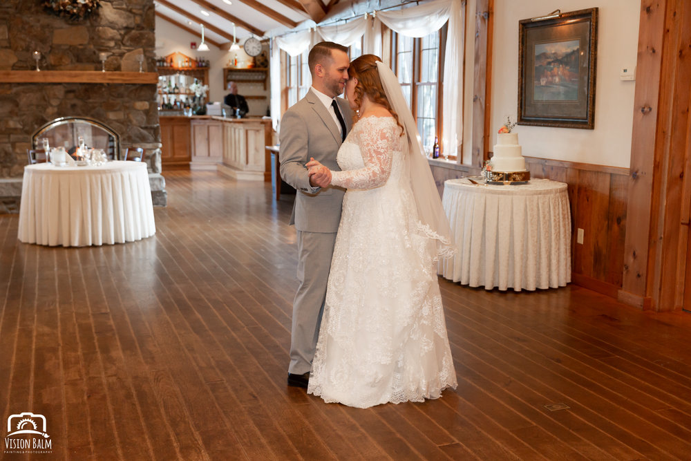 Wedding photo of bride and groom dancing in the venue of Zuka's Hilltop Barn by Vision Balm in Charleston, SC.