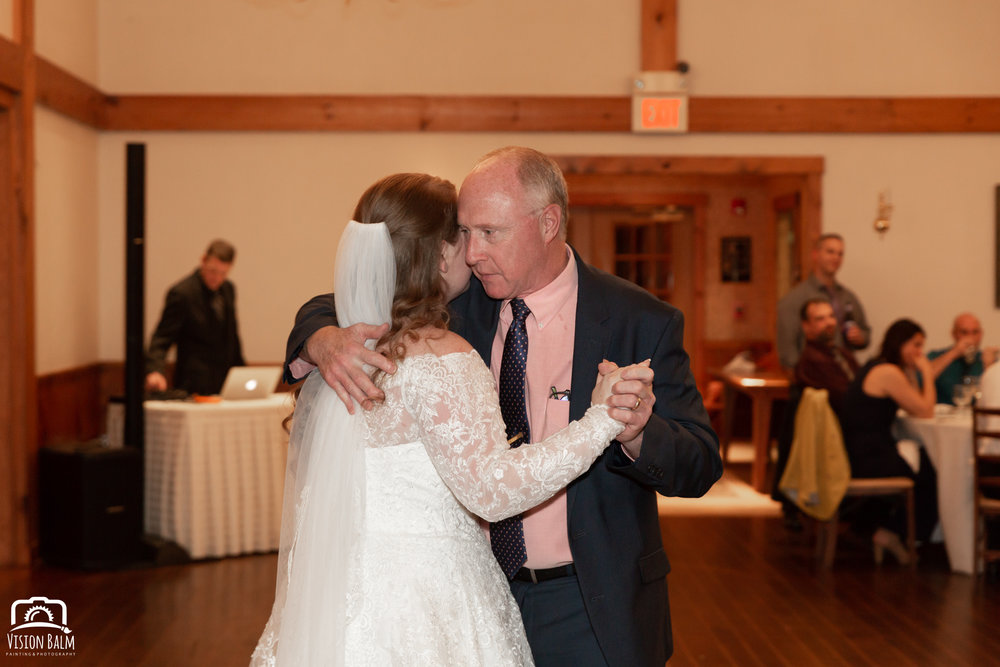 Wedding photo of bride and her father dancing in the venue of Zuka's Hilltop Barn by Vision Balm in Charleston, SC.