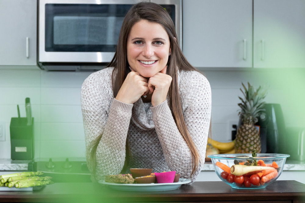 Lifestyle portrait photography of Erin Kenney from Nutrition Rewired registered dieititan leaning on her kitchen counter photographed by Vision Balm in Charleston, SC.