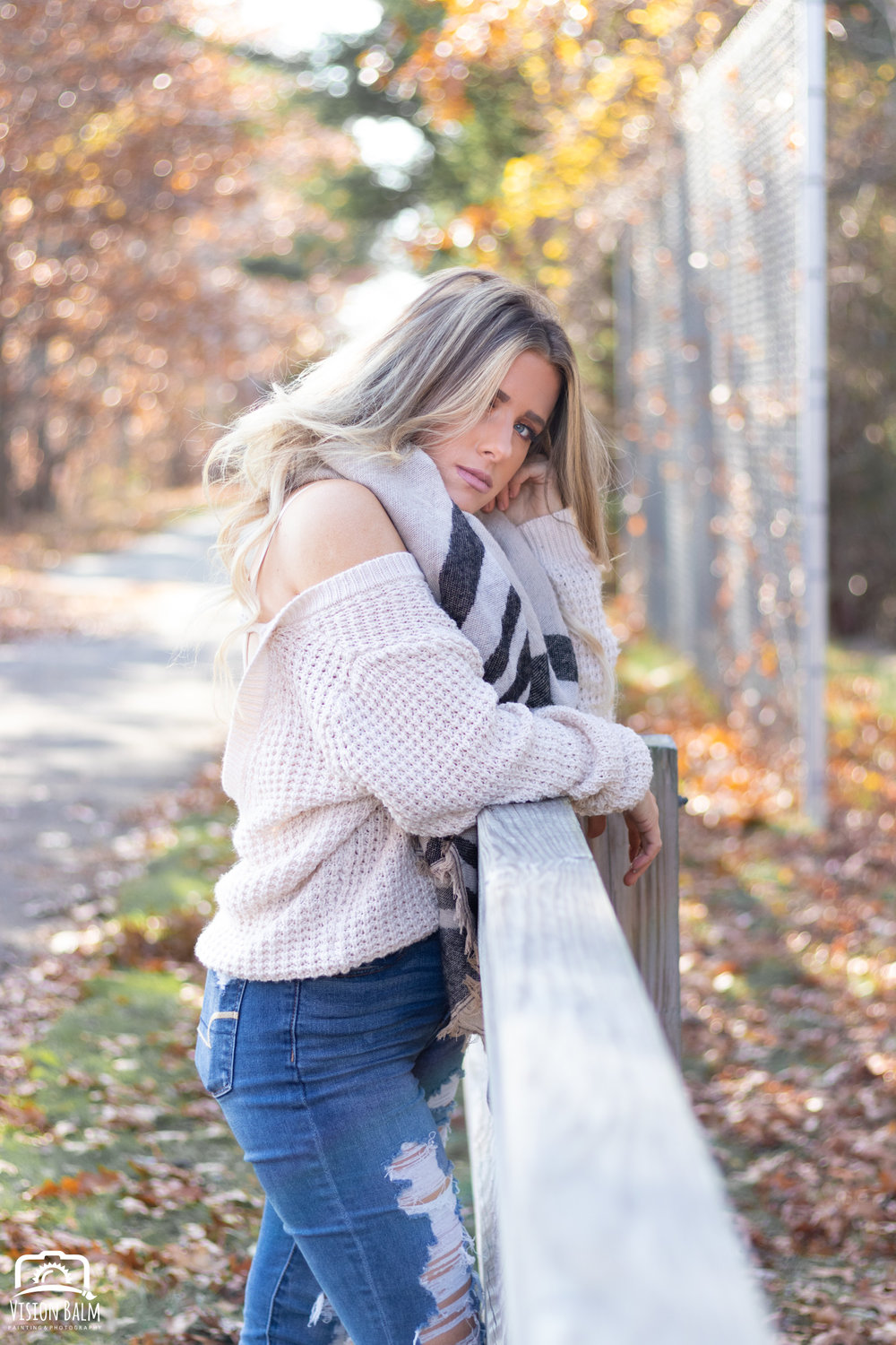 Professional fall portrait photography of model wearing a white sweater and scarf photographed by Vision Balm in Charleston, SC.