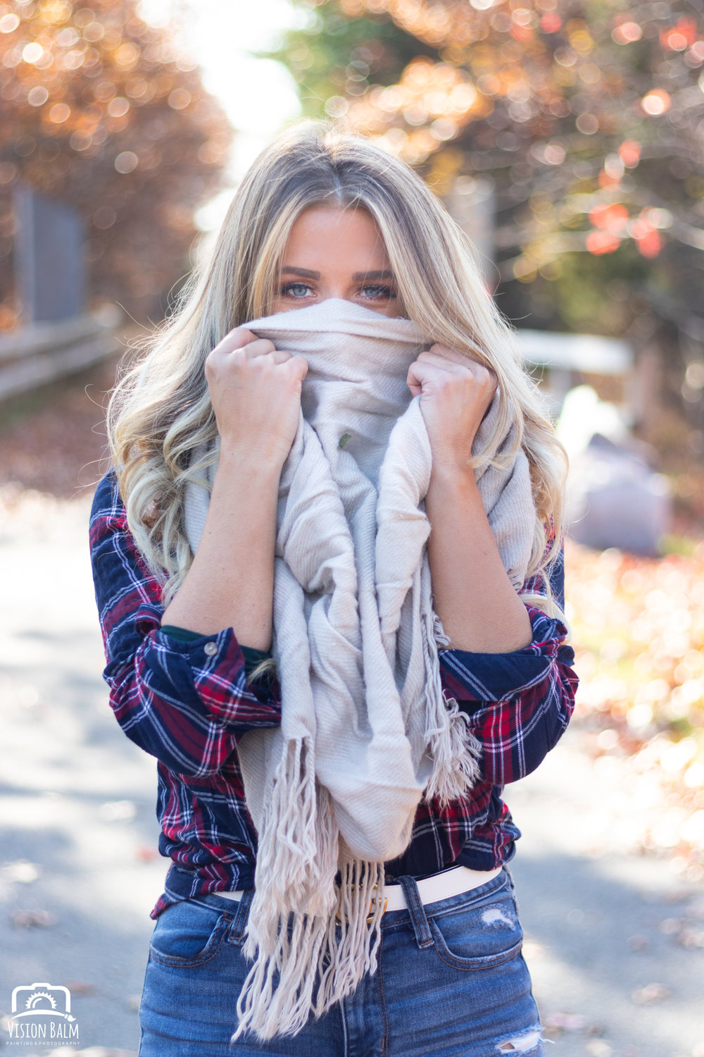 Professional fall portrait photography of model wearing a scarf and plaid shirt photographed by Vision Balm in Charleston, SC.