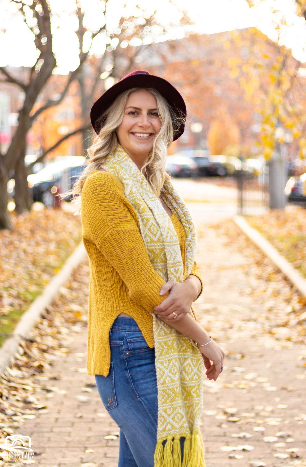Professional fall portrait photography of model wearing a yellow sweater and hat photographed by Vision Balm in Charleston, SC.