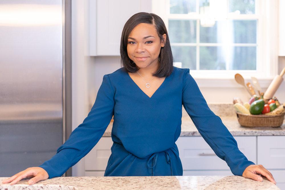 Portrait / headshot of Enjie M.K., aspiring RD, in the kitchen, by Vision Balm in Charleston, SC