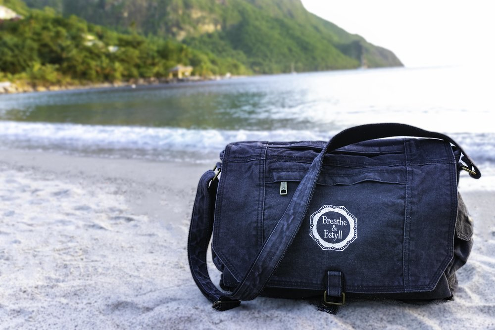 Product photography / photographer of Breathe & Bstyll satchel on Sugar Beach in St. Lucia by Vision Balm based in Charleston, SC