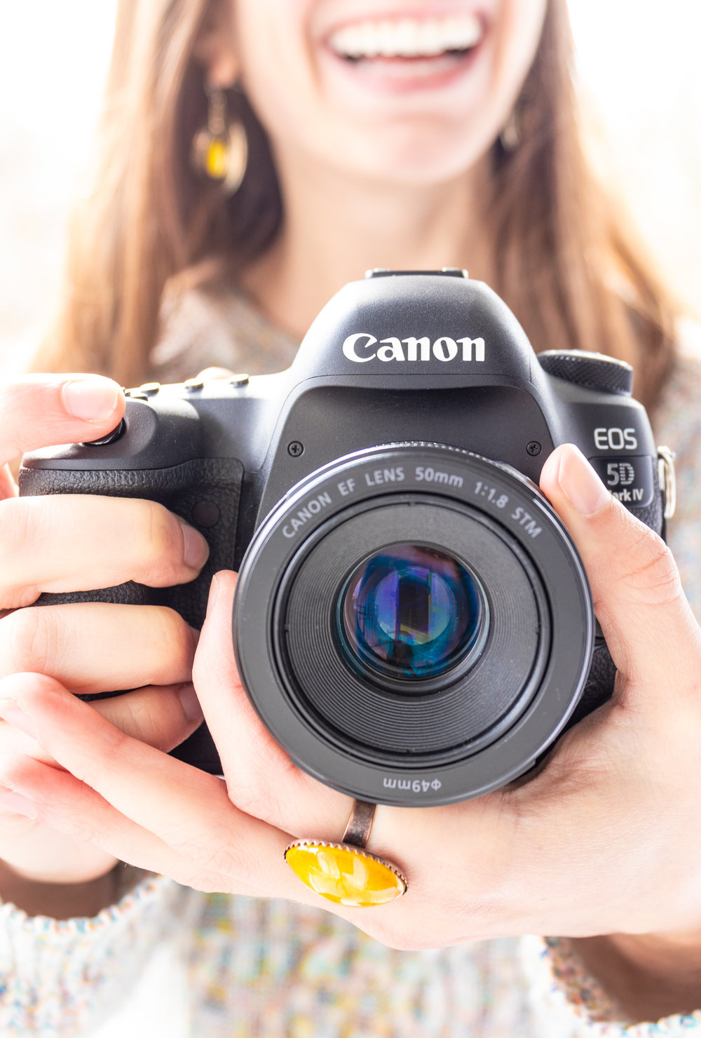 5 reasons to invest in personal branding photography, Michelle of Vision Balm in Charleston, SC holding Canon 5D Mark IV.