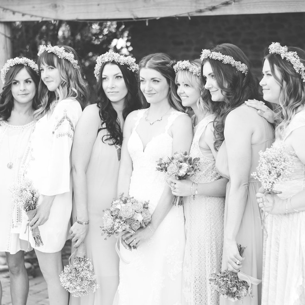 bohemian bridesmaids in flower crowns and mismatched dresses
