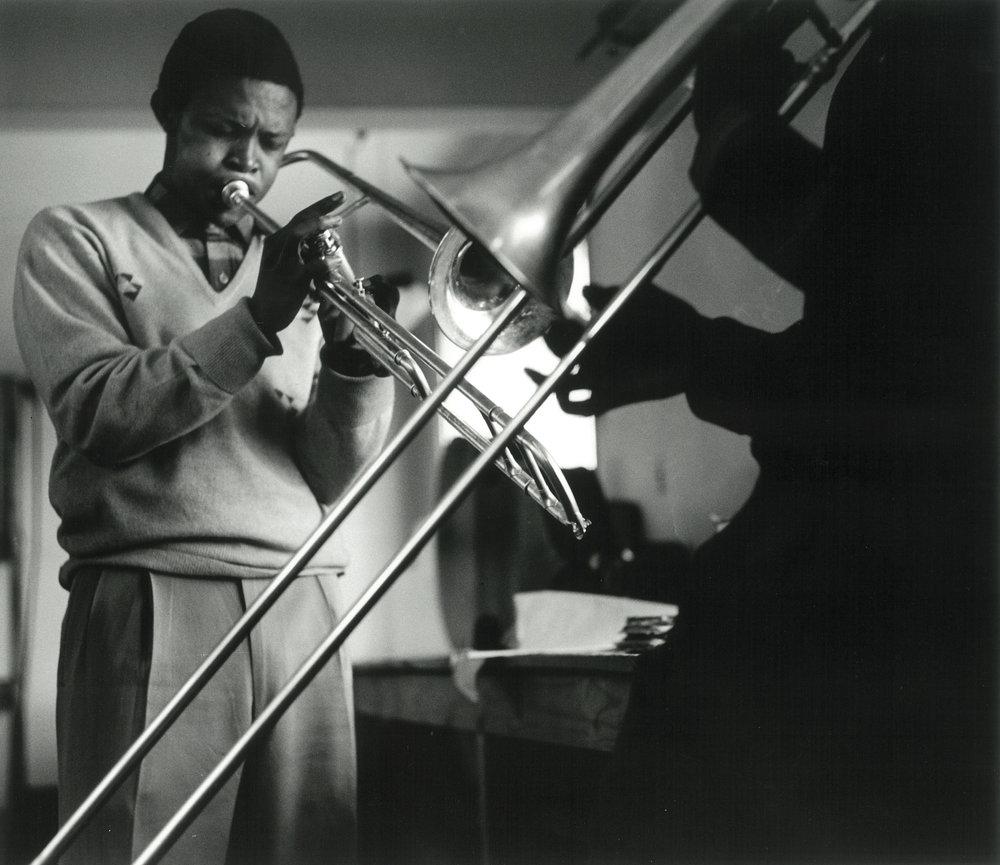 1956 – Hugh Masakela and Jonas Gwangwa practice at the Bantu Men's Social Club, Johannesburg   Courtesy of the Estate of John Goldblatt