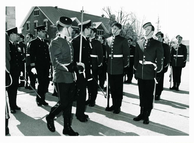 CWC Pete Avis escorting the Cmdt, BGen John de Chastelain, during inspection followed by the DCdts, LCol John Annand and RSM, CWO Slaney – Tom Keogh on the end (with sword)