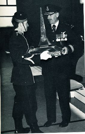 Roger Roy being awarded trophy