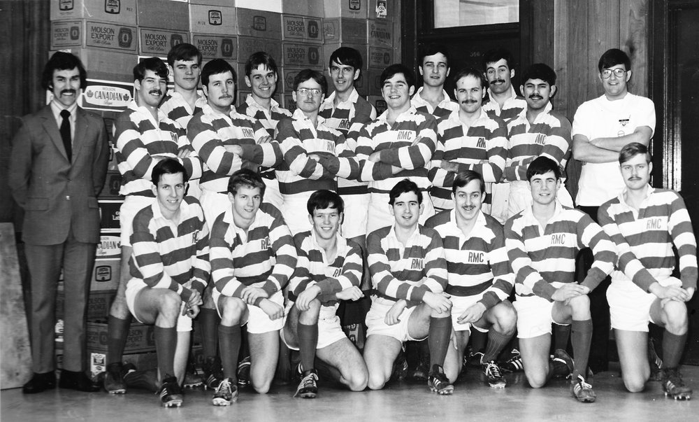 lee in middle back row in rmc rugby team photo