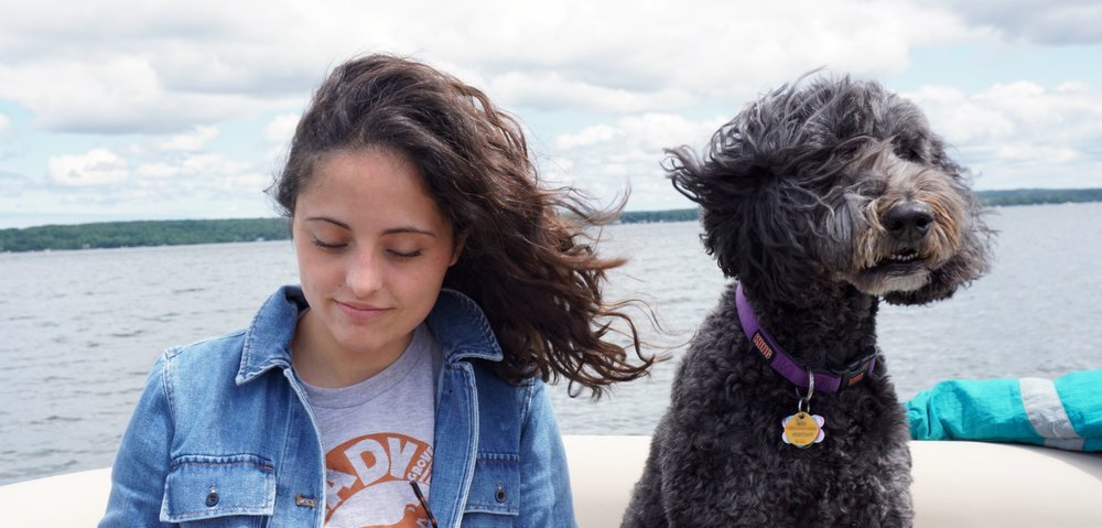 with Molly the Labradoodle on a Michigan lake.