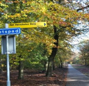 """Signpost to """"Het Verscholen Dorp"""" -the hidden village"""
