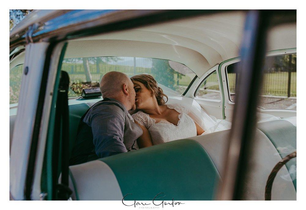 Windy Ridge-wedding-Photo-Couple-kissing-in-car.jpg