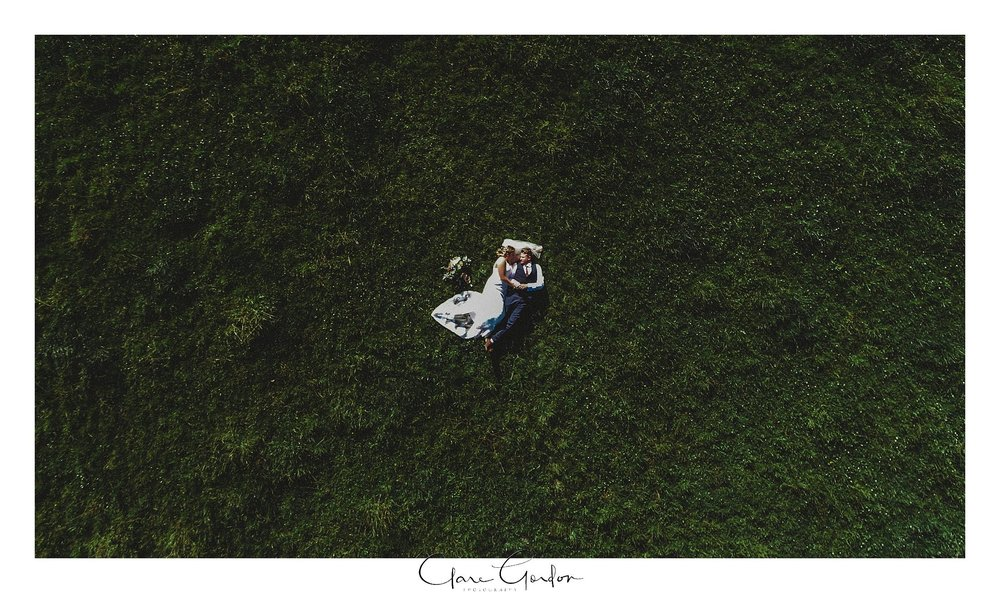 red-barn-wedding-couple-laid-in-field-drone-photo-tirau-waikato-wedding (80).jpg