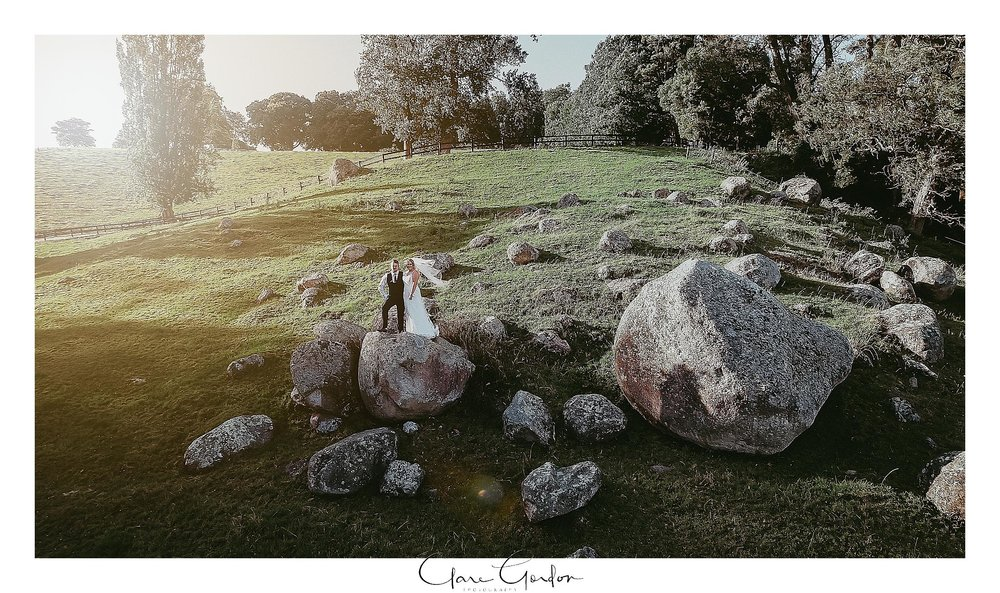 red-barn-wedding-tirau-bride-and-groom-on-rocks-drone-photo-waikato-wedding (90).jpg