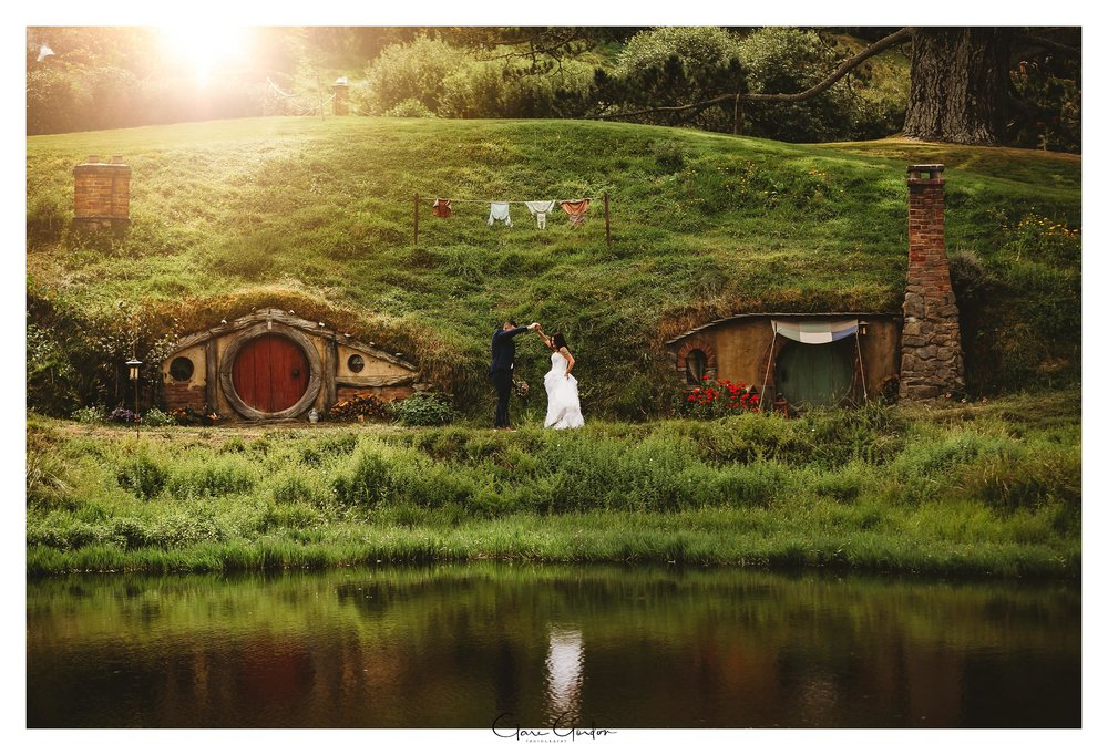 Hobbiton-wedding-photo-Bride-and-groom-Walking-dancing-by-lake (3).jpg