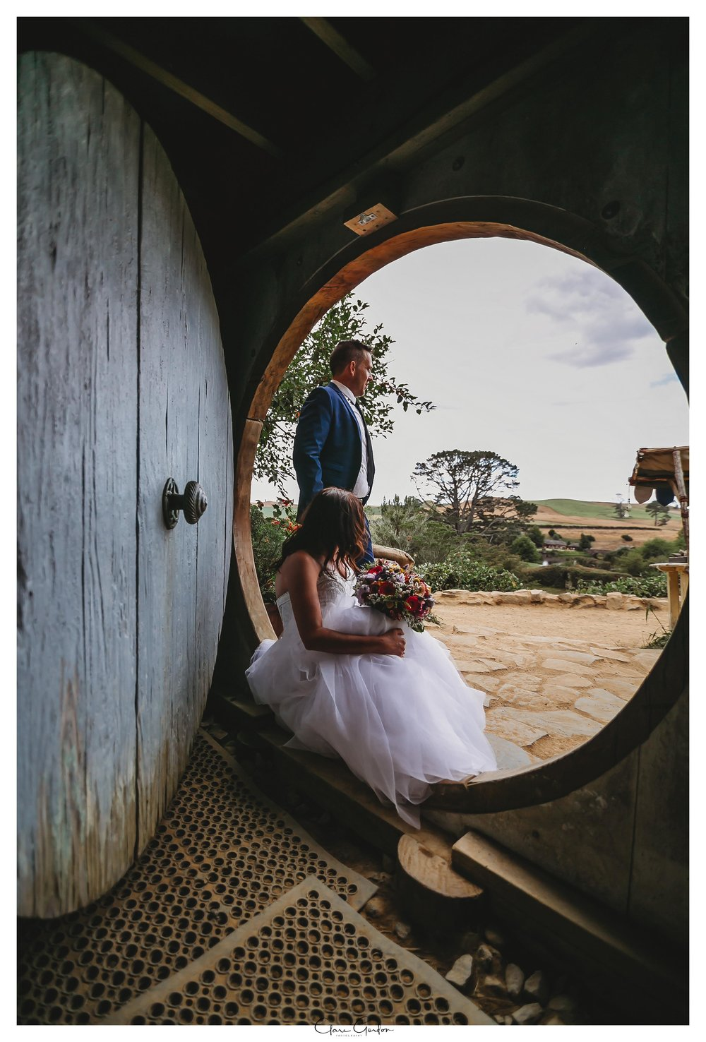 Hobbiton-Wedding-photo-bride-and-groom-looking-out-over-The-Shire
