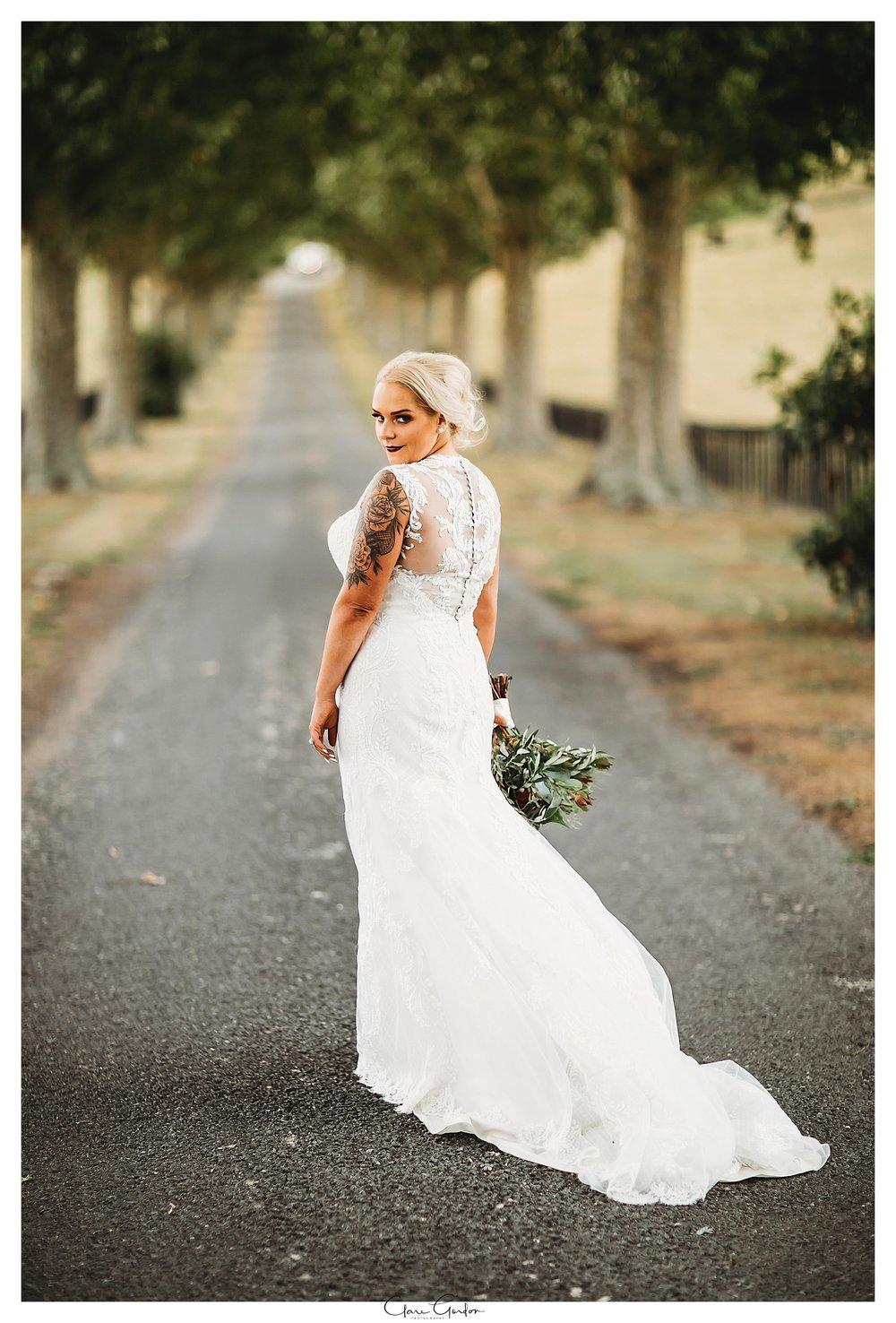 Bride-on-driveway-at-red-barn-Waikato