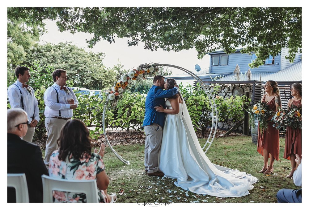 Brie-and-groom-wedding-photo-kiss-Coopers-function-rooms