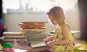 child-reading-stack-300x180.jpg