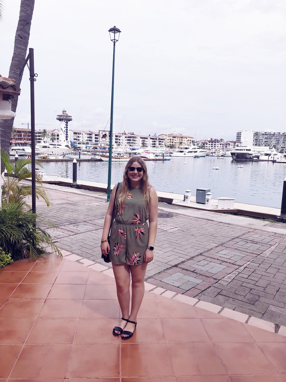 Shopping at the marina in Puerto Vallarta.   A New Day romper.   Steve Madden sandals.   Ray-Ban sunglasses.