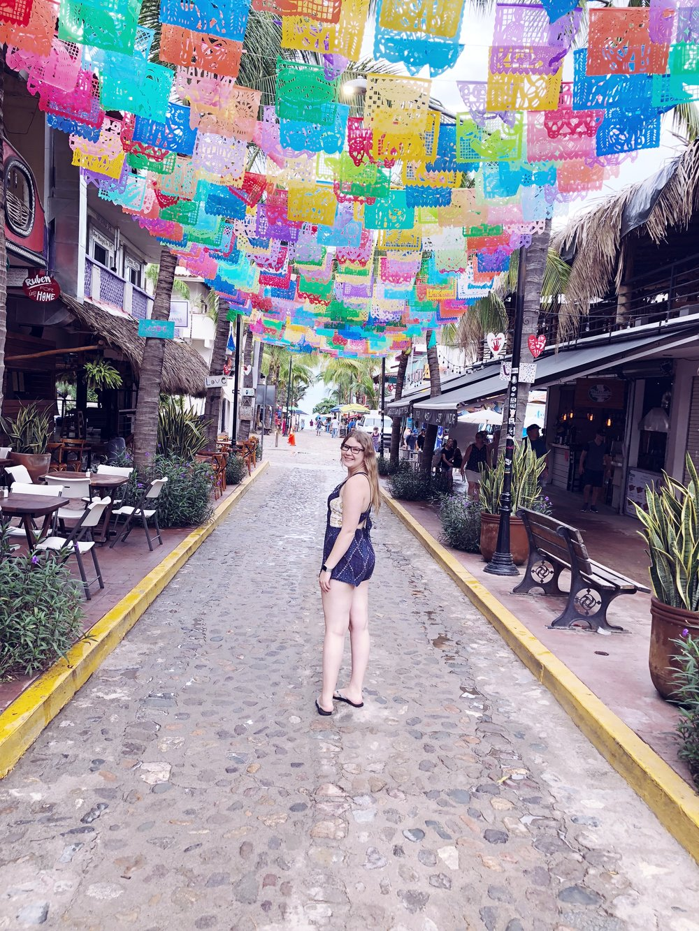 Sayulita is an amazing art and surf community about an hour north of Puerto Vallarta.   Kendall & Kylie romper.