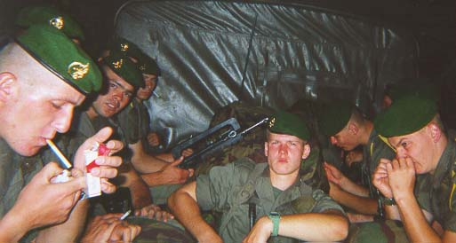 Back of the Truck - Back of the truck bonding with legionnaires who may not have wanted to have their picture taken. Dogs howl when the Legion is on the march. Any village farmer, butcher, or shopkeeper is likely to be shocked to see a band of solders passing, cursing in Polish, Russian, Spanish, English, and thick broken French.